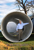 """6' 4"""" Dave Marshall stands inside one of the 9 foot pipes that are being laid in the construction of the water pipeline that will extend from east Texas to Benbrook."""