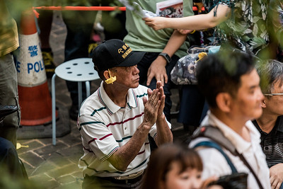 """An elderly man with a """"Hong Konger"""" hat listens to presenters at an event commemorating the 4th anniversary of the Umbrella Revolution in Hong Kong on September 28, 2018."""
