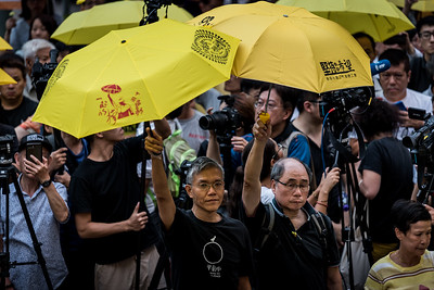 Demonstrators hold up yellow umbrellas at an event commemorating the 4th anniversary of the Umbrella Revolution in Hong Kong on September 28, 2018.