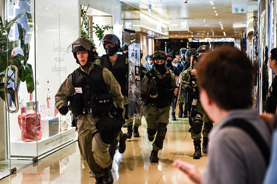 Riot police storm into the Cityplaza Mall in Taikoo Shing, Hong Kong. The mall was full of families, shoppers, and local residents who were rallying against the government and police force. November 3, 2019.