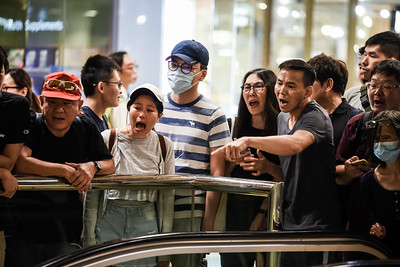 Riot police storm into the Cityplaza Mall in Taikoo Shing, Hong Kong. The mall was full of families, shoppers, and local residents who were rallying against the government and police force. The police quickly took up position and began waving their weapons at the gathered crowd. The people responded by shouting for the police to leave. November 3, 2019.