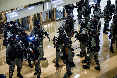 Riot police storm into the Cityplaza Mall in Taikoo Shing, Hong Kong. The mall was full of families, shoppers, and local residents who were rallying against the government and police force. The police quickly took up position and began waving their weapons at the gathered crowd. November 3, 2019.