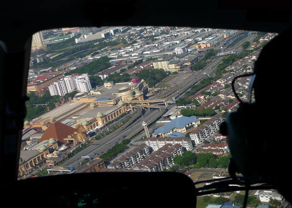 aerial view through the front window of the 'squirrel' helicopter. shadow of pilot on the right. was flying at around 1000ft