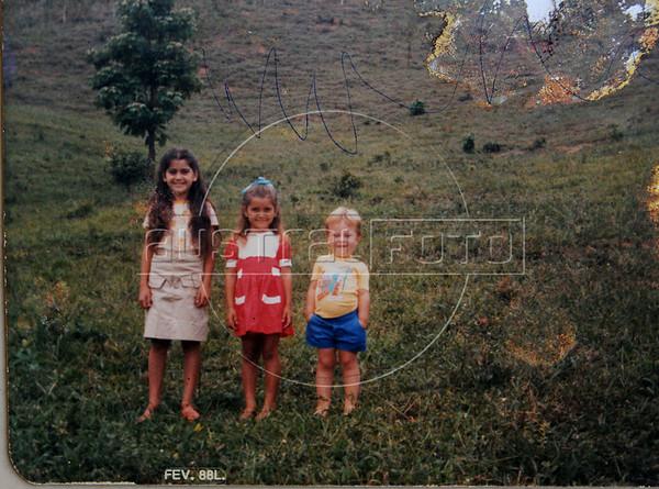REPRODUCTION-Dimas Aliprandi enfant et deux soeurs, Espiritu Santo, Bresil, Mai 20, 2012.  (Austral Foto/Renzo Gostoli)