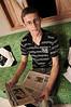 Dimas Aliprandi chez lui avec des journaux publiant articles sur l'echange des bebes, Espiritu Santo, Bresil, Mai 18, 2012.  (Austral Foto/Renzo Gostoli)