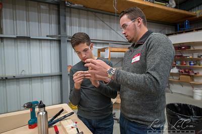 Matthew Bilotta and Luke Soto practice riveting and deburring metal parts