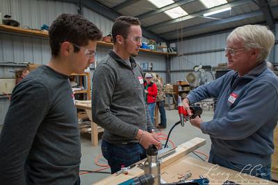 Mentor Buzz Wells shows Matthew Bilotta and Luke Soto the finer points of metal riveting