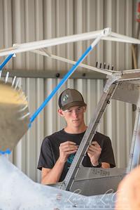 Student Ethan Tenderholt works on the cockpit