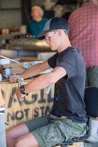 Ethan Tenderholt cuts a length of tubing