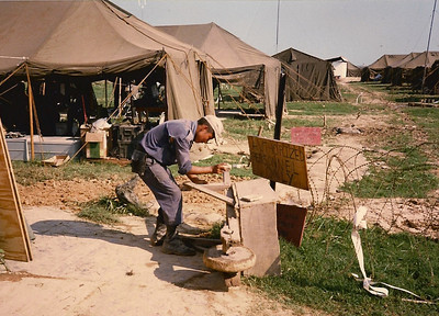 Bolivian airman maintaining some earth moving equipment