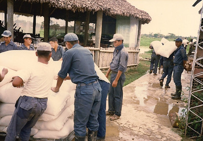 Bolivian airmen moving bags of rice