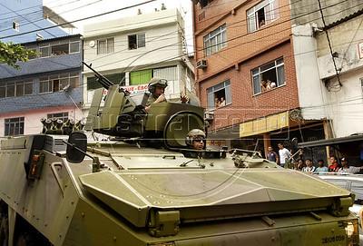 Brazilian marines on an amphibious assault vehicle (AAV) patrol a street of the Rocinha shantytown, Rio de Janeiro, Brazil, November 13, 2011. (Austral Foto/Renzo Gostoli)