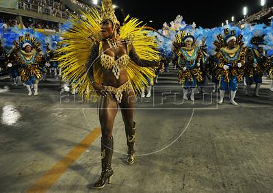 A samba dancer performs at the Sambadrome during the Unidos da Tijuca samba school parade,  Rio de Janeiro, Brazil, February 10, 2013. The Unidos da Tijuca Samba school parade pays tribute to Germany during Rio de Janeiro's 2013 carnival celebrations. (Austral Foto/Renzo Gostoli)