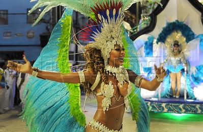 A samba dancer performs at the Sambadrome during the samba school parade,  Rio de Janeiro, Brazil, February 10, 2013.  (Austral Foto/Renzo Gostoli)