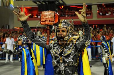 A member of Unidos da Tijuca samba school performs at the Sambadrome during the samba school parade, Rio de Janeiro, Brazil, February 10, 2013. The Unidos da Tijuca Samba school parade pays tribute to Germany during Rio de Janeiro's 2013 carnival celebrations. (Austral Foto/Renzo Gostoli)