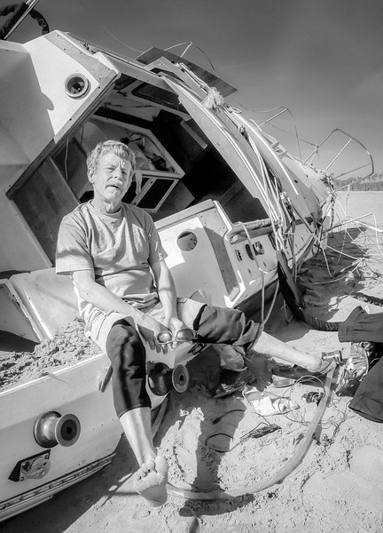 Jeff Catlin sitting on the ruins of his storms wrecked sailboat on Santa Barbara's East Beach, says that he's learned to make lemonade from life's lemons. he lost his foot in a construction accident and has also survived a six story fall from the top of a building. He landed in a pile of garbage.