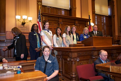 Girls Scouts, Marilyn Midyette, Representative Dobbs, and Speaker of the House Ralston on the dais to hear the reading of the proclamation