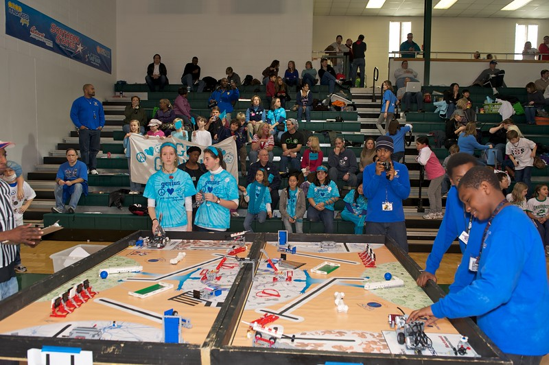 Robots negotiate obstacles and perform tasks according to instructions the teams program into them