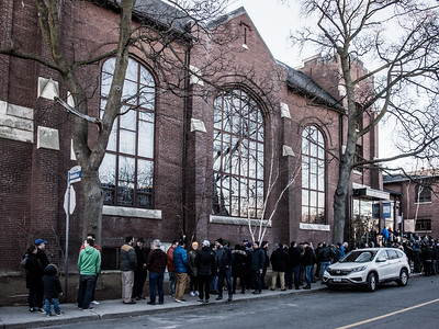 Ticketholders line up outside of the Eastminster United Church for Greektown Wrestling in Toronto. March 18, 2018.