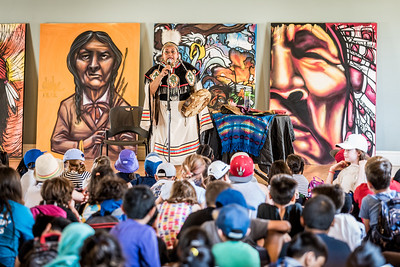 Kim Wheatley tells a story to a group of children at the opening of the Indigenous Arts Festival at Fort York in Toronto. June 21, 2018.