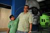 FLUPP - Marcus Cruz, participante do FLUPP, com seu filho, no Centro Cultural Cartola, Mangueira, Rio de Janeiro, Brasil, Junho 30, 2012.  (Austral Foto/Renzo Gostoli)