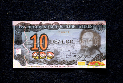 Image of a bill, social currency Cidade de Deus, issued by the Community Bank of Cidade de Deus, Rio de Janeiro, Brazil, September 15, 2011. The Brazilian favela City of God, received today the first branch of Community Bank, as a new experience to stimulate the activity economic in poor communities. (Austral Foto/Renzo Gostoli)