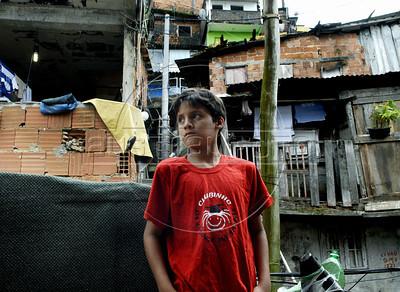 CLUBINHO DA CRIANCA-PLANETARIO -   Carlos Henrique Pereira de Souza na varanda da sua casa na favela Santa Marta,  Rio de Janeiro, Brasil, Novembro 26, 2011.  (Austral Foto/Renzo Gostoli)