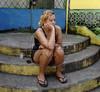 Santa Marta-  Francileide Moraes, moradora de Santa Marta, numa ruela da favela,  Rio de Janeiro, Brasil, Marco 14, 2011.  (Austral Foto/Renzo Gostoli)