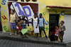 """Criancas do projeto - Otavio Cesar Junior """"O livreiro do Alemao"""", fundador do projeto """"Ler  é Dez – Viva Favela!"""" no Complexo do Alemao, Rio de Janeiro, Brazil, junho 24, 2011. (Austral Foto/Renzo Gostoli)"""