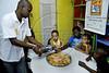 """Otavio Cesar Junior """"O livreiro do Alemao"""", fundador do projeto """"Ler  é Dez – Viva Favela!"""" na biblioteca no Complexo do Alemao, Rio de Janeiro, Brazil, junho 24, 2011. (Austral Foto/Renzo Gostoli)"""