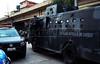 """FAVELA DO CAJU - Veiculos blindados """"Caveirao"""" da Policia Militar participam da ocupaçao do complexo de favelas do Caju, Rio de Janeiro, Brasil, Março 3, 2013.   (Austral Foto/Renzo Gostoli)"""