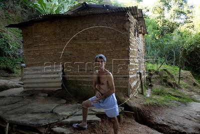 TRILHAS-  Morro da Babilonia. Seu Antonio de Souza, de 68 anos, mora, desde que nasceu, na última casinha do morro, na beira da trilha, Rio de Janeiro, Brasil, Marco 22, 2011.  (Austral Foto/Renzo Gostoli)
