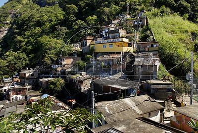 TRILHAS-  Santa Marta. Favela Santa Marta, Rio de Janeiro, Brasil, Junho 5, 2011.  (Austral Foto/Renzo Gostoli)