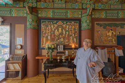 Inside the Buddha Hall, monk Juji Sunim explains the prayer table
