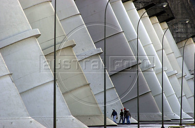 Workers walk between the huge water intake pipes at the Binational Itaipu Hydroelectric plant in Foz do Iguacu, Brazil, and Ciudad del Este, Paraguay.(Douglas Engle/Australfoto)