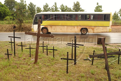 A bus passes a memorial to Landless Peasant (MST) massacre victims, made of 19 crosses, on the side of the PA-150 highway near Carajas in southern Par‡ state, Brazi. In what ins now known as the Carajas Massacre, 19 MST members were killed April 19, 1996 when state police opened fire on hundreds of protesting MST members who had blocked the highway to demand land reform. Other two victims died from the wounds some years later. (Australfoto/Douglas Engle)