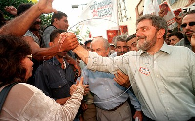 """Presidential Candidate Luiz Inacio """"Lula"""" da Silva greets well-wishers in Campo Grande, in the state of Rio de Janeiro, Brazil, Tuesday, September 22, 1998. Lula, as he is known, of a left-wing coalition lost the election to incumbant Fernando Henrique Cardoso, but became president 4 years later. (Australfoto/Douglas Engle)"""