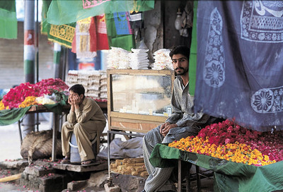 Shops surrounding the shrine sell everything from foodstuff to fabric to offerings for the shrine. Gujrat, Pakistan