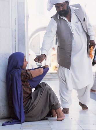 The chuhas are sent to beg by the extended family who have historically tended the shrine. The money given to the chuhas is taken by the family. Gujrat, Pakistan.