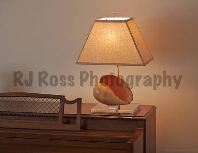 Melon shell table lamp atop a piano clearly shows the size of these magnificent shells