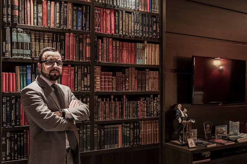CURITIBA, BRAZIL. August, 3rd - 2015. Dr. Tracy Reinaldet, standing in his office's library. He is on of the attorneys for Alberto Youssef, who's been charged of corruption in the Petrobras case, the large brazilian oil company. Portraits / Retratos