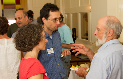 Wendy and Jonathan Teller-Elsberg of Norwich, VT, in discussion with Vermont House Representative Jim Masland (right) at a customer appreciation event held by Vermont-based Solaflect Energy.