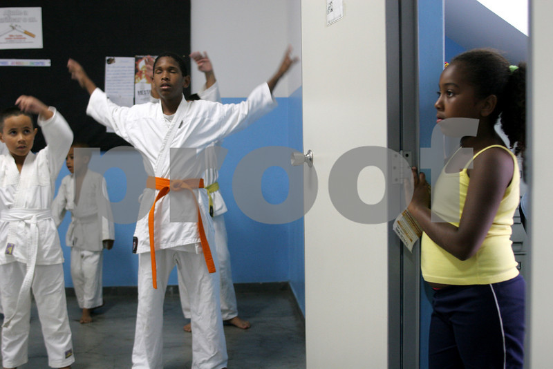 Young people attend a karate class at the Center for Citizenship, Cultural Actions and Studies (CEACC) of the Cidade de Deus (City of God) slum in Rio de Janeiro, Brazil. The CEACC is an NGO  founded in 2001 by current and former residents to combat economic, social and racial prejudice in the slum. It is supported in a large part by the British NGO Action Aid. Among the programs offered by the center are Football, Karate, Dance, Computer labs and tutoring. The CEACC building was bought in 2005 through a donation from British national Olga Jablkowska, and as been an important part of the success of the organization.(AustralFoto/Douglas Engle)
