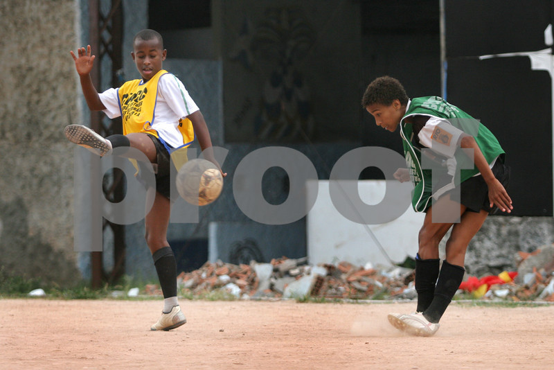 Young people attend football training at the Center for Citizenship, Cultural Actions and Studies (CEACC) of the Cidade de Deus (City of God) slum in Rio de Janeiro, Brazil. The CEACC is an NGO  founded in 2001 by current and former residents to combat economic, social and racial prejudice in the slum. It is supported in a large part by the British NGO Action Aid. Among the programs offered by the center are Football, Karate, Dance, Computer labs and tutoring. The CEACC building was bought in 2005 through a donation from British national Olga Jablkowska, and as been an important part of the success of the organization.(AustralFoto/Douglas Engle)