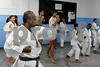 Atila de Brito instructs young people during a karate class at the Center for Citizenship, Cultural Actions and Studies (CEACC) of the Cidade de Deus (City of God) slum in Rio de Janeiro, Brazil. The CEACC is an NGO  founded in 2001 by current and former residents to combat economic, social and racial prejudice in the slum. It is supported in a large part by the British NGO Action Aid. Among the programs offered by the center are Football, Karate, Dance, Computer labs and tutoring. The CEACC building was bought in 2005 through a donation from British national Olga Jablkowska, and as been an important part of the success of the organization.(AustralFoto/Douglas Engle)