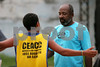 Ze Carlos Lopes coaches young people during football training at the Center for Citizenship, Cultural Actions and Studies (CEACC) of the Cidade de Deus (City of God) slum in Rio de Janeiro, Brazil. The CEACC is an NGO  founded in 2001 by current and former residents to combat economic, social and racial prejudice in the slum. It is supported in a large part by the British NGO Action Aid. Among the programs offered by the center are Football, Karate, Dance, Computer labs and tutoring. The CEACC building was bought in 2005 through a donation from British national Olga Jablkowska, and as been an important part of the success of the organization.(AustralFoto/Douglas Engle)