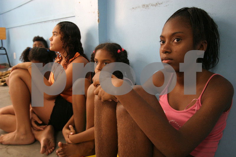 Young people attend a dance class at the Center for Citizenship, Cultural Actions and Studies (CEACC) of the Cidade de Deus (City of God) slum in Rio de Janeiro, Brazil. The CEACC is an NGO  founded in 2001 by current and former residents to combat economic, social and racial prejudice in the slum. It is supported in a large part by the British NGO Action Aid. Among the programs offered by the center are Football, Karate, Dance, Computer labs and tutoring. The CEACC building was bought in 2005 through a donation from British national Olga Jablkowska, and as been an important part of the success of the organization. (AustralFoto/Douglas Engle)