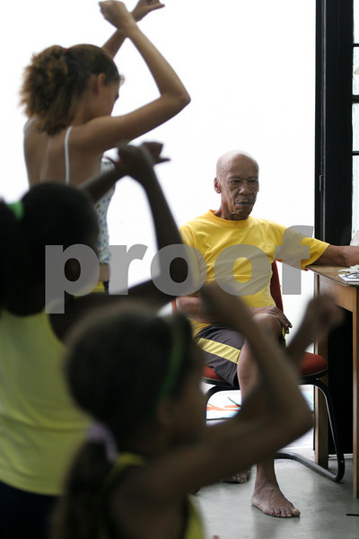 Dance instructor Gilberto de Assis watches over a class at the Center for Citizenship, Cultural Actions and Studies (CEACC) of the Cidade de Deus (City of God) slum in Rio de Janeiro, Brazil. The CEACC is an NGO  founded in 2001 by current and former residents to combat economic, social and racial prejudice in the slum. It is supported in a large part by the British NGO Action Aid. Among the programs offered by the center are Football, Karate, Dance, Computer labs and tutoring. The CEACC building was bought in 2005 through a donation from British national Olga Jablkowska, and as been an important part of the success of the organization. (AustralFoto/Douglas Engle)