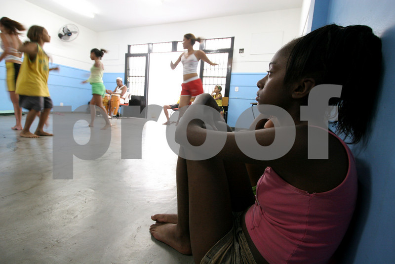 Young people attend a dance class at the Center for Citizenship, Cultural Actions and Studies (CEACC) of the Cidade de Deus (City of God) slum in Rio de Janeiro, Brazil. The CEACC is an NGO  founded in 2001 by current and former residents to combat economic, social and racial prejudice in the slum. It is supported in a large part by the British NGO Action Aid. Among the programs offered by the center are Football, Karate, Dance, Computer labs and tutoring. The CEACC building was bought in 2005 through a donation from British national Olga Jablkowska, and as been an important part of the success of the organization.(AustralFoto/Douglas Engle)