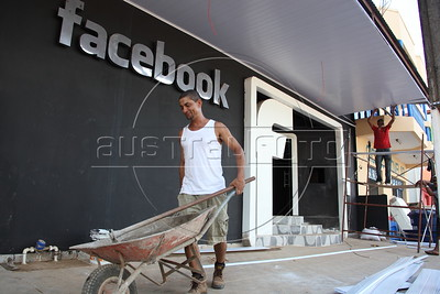 "Workers prepare the ""Facebook"" club for inauguration in Epitaciolandia, Brazil, In the Amazonian state of Acre, just across the border from Bolivia. Brazil is one of the fastest-growing facebook using nations. (Douglas Engle/Australfoto)"